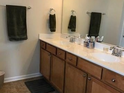 Double vanity in master bath. Not pictured is large shower with built-in bench.